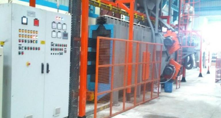 Continuous shot blasting machine with overhead conveyor - VPP